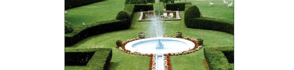 Manicured Lawn with water fountain and flower beds