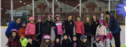 Large group photo of children skaters and instructors